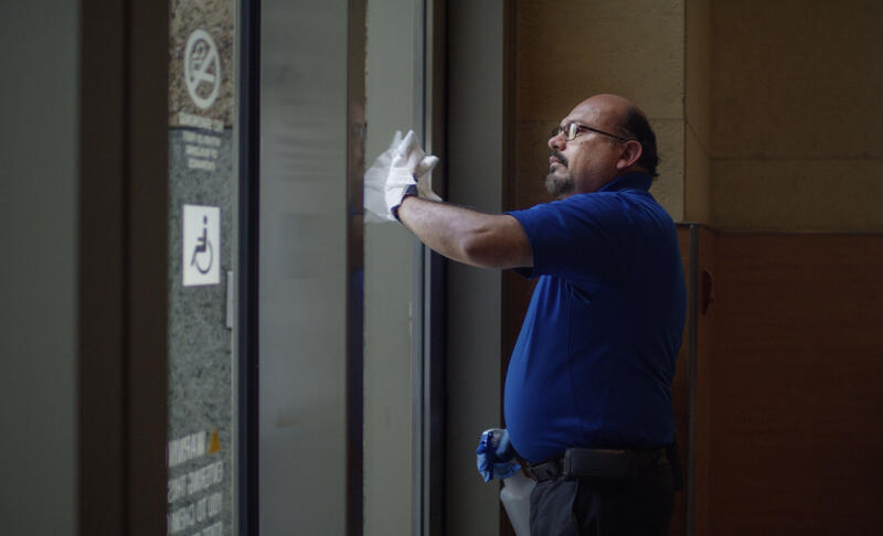 An Able employee cleaning a building