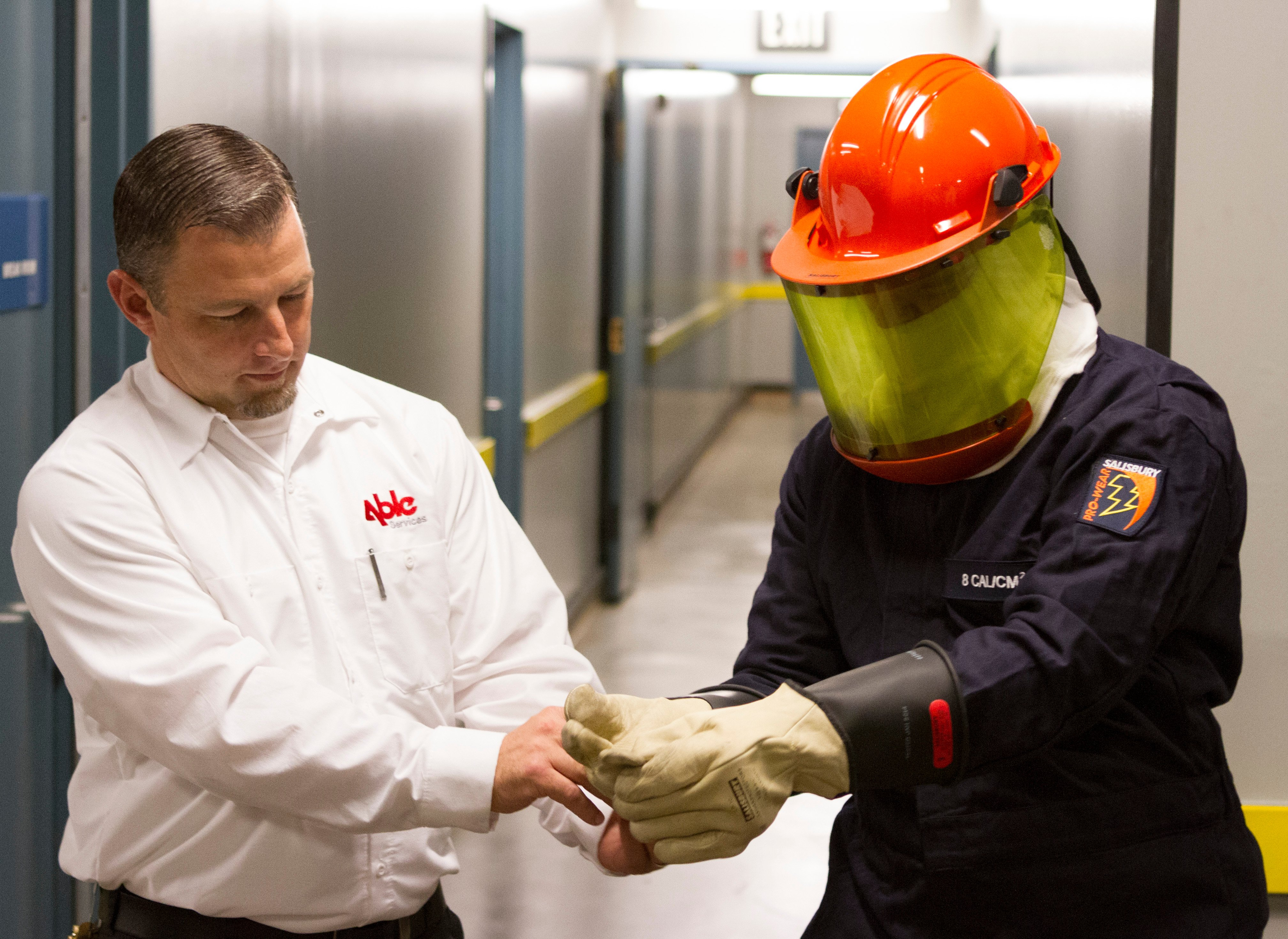 An Able employee helping an electrician stay safe